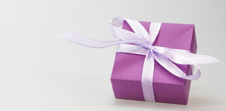 purple present with mauve ribbon