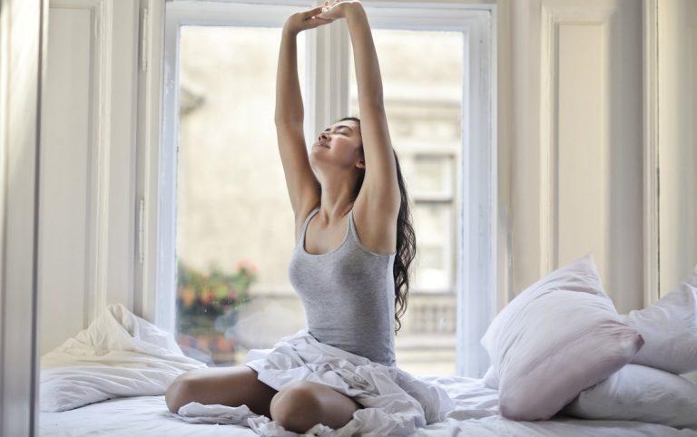 female waking up from sleep