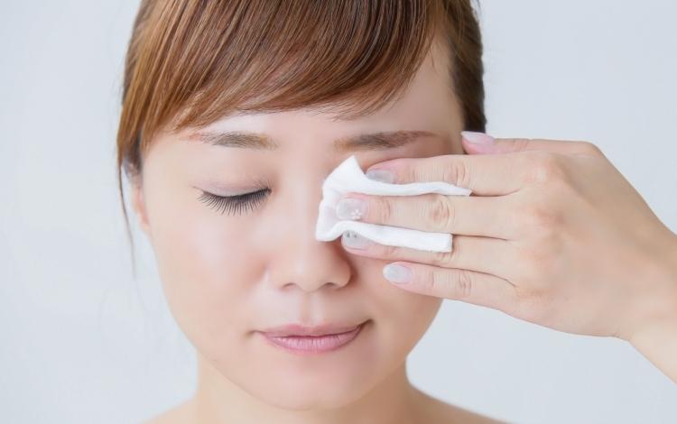 female removing makeup