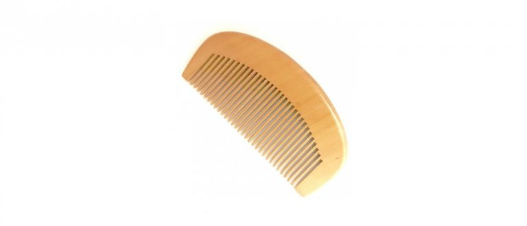 wooden comb with a white background