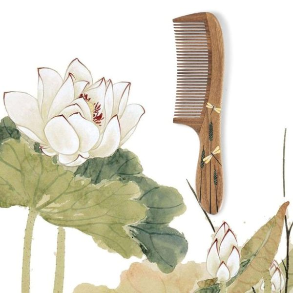 Wooden Comb with dragon fly designs on a Chinese painting of lotus flowers