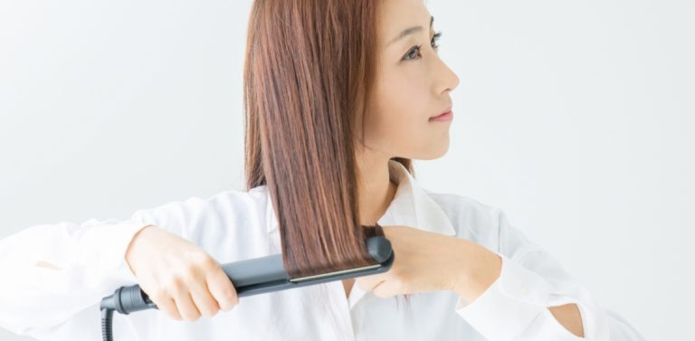 female with curling iron