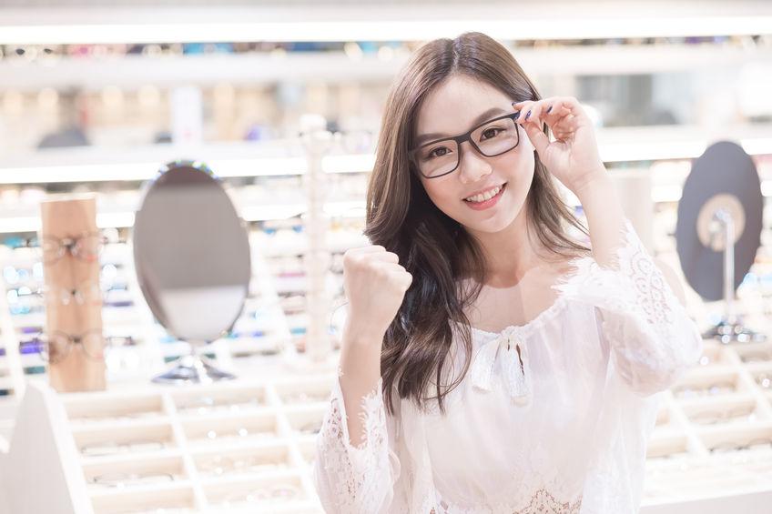 female trying glasses