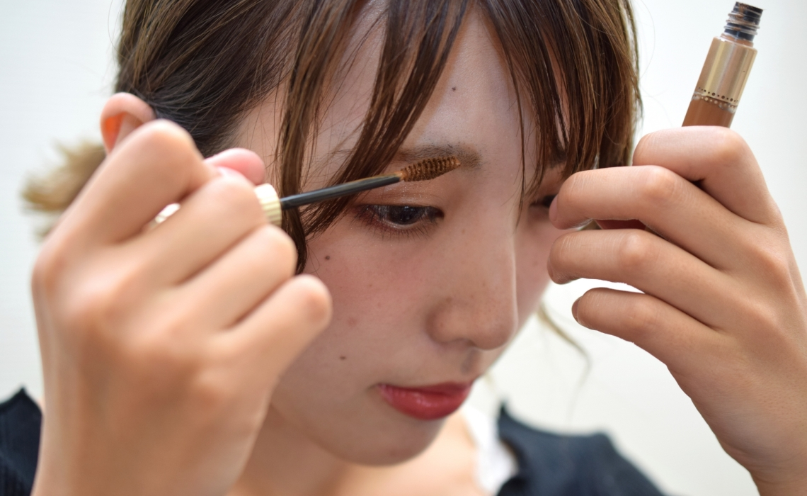 female applying eyebrow mascara